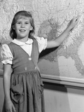 1960s School Girl Pointing to Map of the Usa