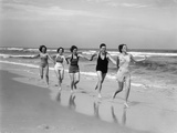 1930s Four Women and One Man Running on Beach Holding Hands