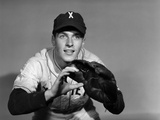 1950s Baseball Player with Glove Poised to Catch Ball Keeping His Eye on the Ball