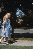 Two Blond Girls Wearing Blue Dresses on the First Day of School