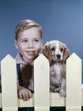 1960s Boy Puppy Dog Looking over White Picket Fence
