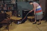 Woman Vacuuming Living Room