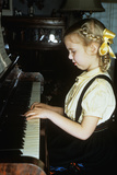 Little Blond Girl Playing Practicing the Piano