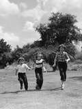 1950s Three Girls Running in Grassy Field