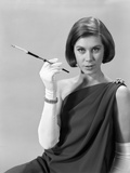 1960s Formally Elegantly Dressed Young Woman with a Cigarette Holder Wearing Long White Gloves