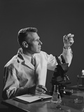 Man Scientist Holding Test Tube Making Notes