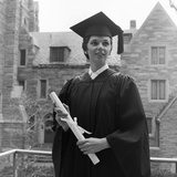 1950s Smiling Female Graduate Holding a Diploma