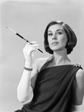 1960s Formally Elegantly Dressed Young WomanHolding Long Cigarette Holder Wearing Long White Gloves