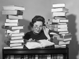 1950s Portrait of Woman Sitting with Stacks of Books