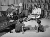 1960s Family of Four in Living Room Boy Is Being Disciplined by Dad Shaking Finger