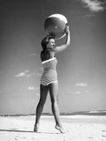1960s Woman in Stripes Swim Suit Bathing Holding Beach Ball Standing on Tip Toes