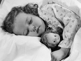 1950s Child Little Girl Sleeping in Bed with Doll