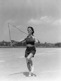 1930s Woman Jumping Rope Exercise Outdoors Wearing Polka Dot Halter Top and Shorts