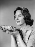 1950s-1960s Woman Smelling Aroma of Freshly Baked Pie