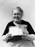 1930s-1940s Elderly Character Woman Smiling Reading Letter Wearing Apron