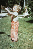 1950s Little Boy Outside Drinking Soda from a 7Up Bottle 1951