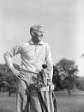 1960s Smiling Blond Man Standing with Golf Bag Looking Down Fairway