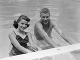 1950s Teen Couple in Swimming Pool Smiling