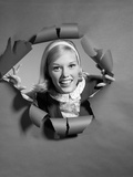 1960s Blond Woman Breaking Through Ripped Paper Smiling Wearing Headband