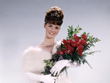 1960s Woman Prom Queen Wearing White Evening Dress Holding Bouquet of Flowers Red Roses