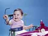 1960s Smiling Baby Holding Eyeglasses