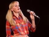 1970s Blond Woman Ponytails Long Hair Microphone Plaid Shirt Singing Folk Music