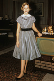 1950s Teenage Girl Dressed for Her First Date in Gray Silky Dress Posed by Television Set