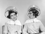 1960s Two Women Sitting under Hairdryers Gossiping