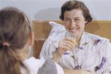 Mother Enjoying Glass of Orange Juice in Bed