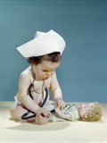 1960s Baby Wearing Nurse Nurse's Cap Stethoscope Listening to Doll Heartbeat Chest