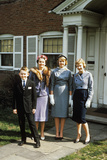 1950s Mother with Teenage Girls and Younger Son Dressed Up Posing in Front of House
