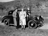 Father and Mother Stand with their Son Sitting on the Hood of their Mercedes Automobile  Ca 1950