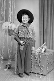 Ten-Year-Old Boy Poses in a Cowboy Outfit  Ca 1951