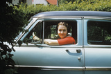1950s Woman Driver Looking Out of Car Window