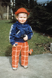1950s Little Boy in Red Hat Standing Outside Holding Toy 1951