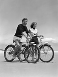 1950s Teenage Boy and Girl with Bikes on the Beach