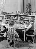 1950s 4 Pre-School Age Children Seated at Small Round Table Putting Together Jigsaw Puzzle
