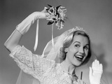 1950s Bride Throwing Bouquet and Waving Goodbye Smiling