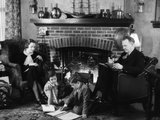 1930s Family of Four Sitting in Front Fireplace