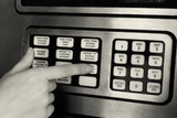 1980s Hand Pressing Buttons on Panel of Vintage Automatic Teller Machine ATM