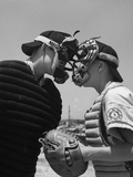 1950s Boys in Baseball Uniforms Face to Face Arguing Umpire and Catcher