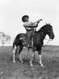 1920s Cowboy on Horse Singing and Playing Guitar