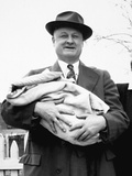 Mature Man Holds a Baby  Ca 1950