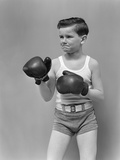 1940s Boy Child Wearing Boxing Gloves Standing Ready to Fight