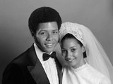 1970s Portrait Smiling African American Bride and Groom with Arms around Each Other