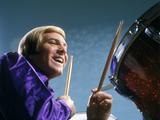 1970s Laughing Blond Man Musician Playing Drums Wearing Purple Shirt