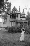 1970s Woman in Victorian Costume Standing on Front Lawn of Large Abandoned Haunted Victorian Home