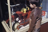 Boy Window Shopping at a Toystore