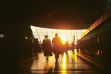 Silhouetted Passengers Walking Interior of Airline Terminal at Sunset  Dulles International