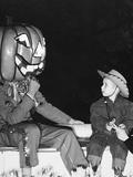Young Boy Warily Eyes Pumpkin Man  Ca 1955